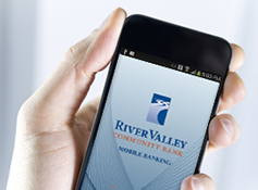 hand holding a mobile phone with the River Valley app displayed